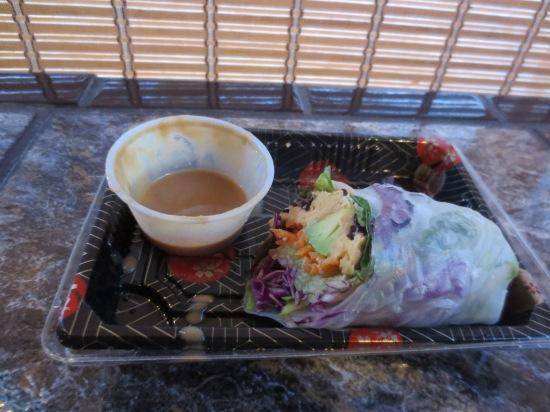 eating a hummus roll @ Koriente