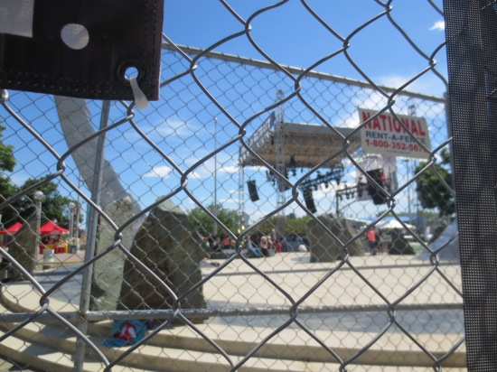 Peering through the fence at the Made In Detroit stage