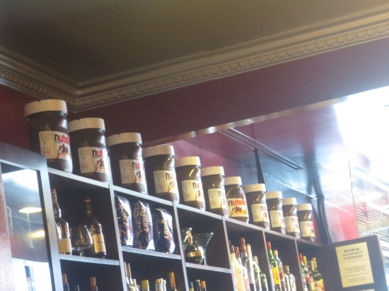 wall of giant nutella jars @ Cafe Crepe