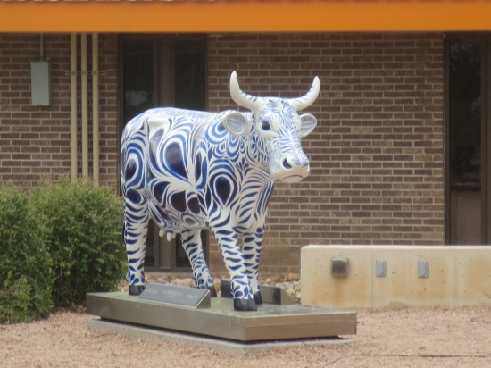 cow sculpture outside Topfer Theatre at ZACH