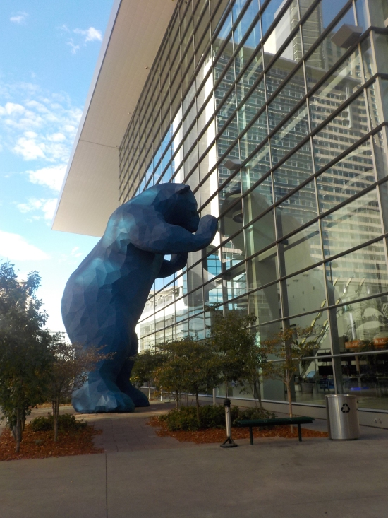 blue bear peeking into the convention center